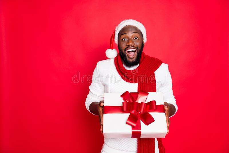 Wow its for me. Portrait of excited african man in santa claus cap hold big package get present for newyear celebration. Wow its for me. Portrait of excited stock photography