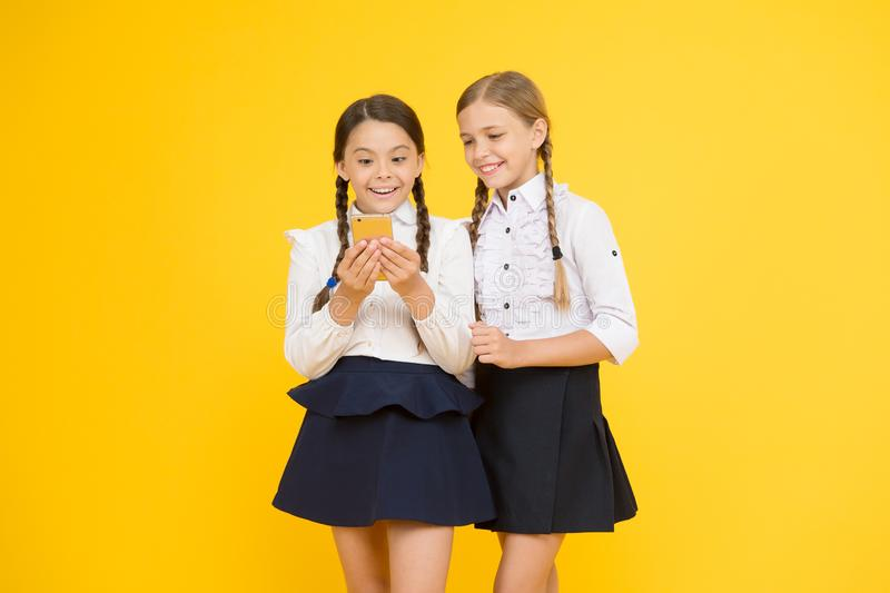 Wow. little girls in school uniform. back to school. educational blog. new technology in education. knowledge day royalty free stock photo