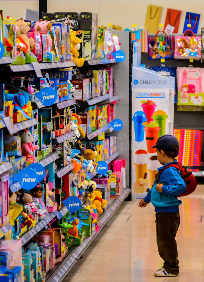 Wow, look at all the toys!. A young child looking at toys royalty free stock photography