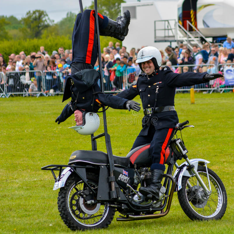 Wow, look at me!. The White Helmets are a group of specially trained British Army stunt motorbike riders who perform at shows throughout the UK royalty free stock photo