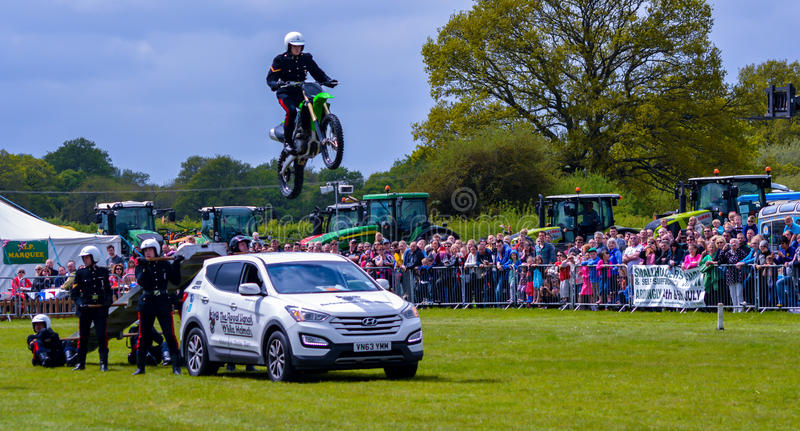 WOW, look at the stuntman. The White Helmets are a group of specially trained British Army stunt motorbike riders who perform at shows throughout the UK
