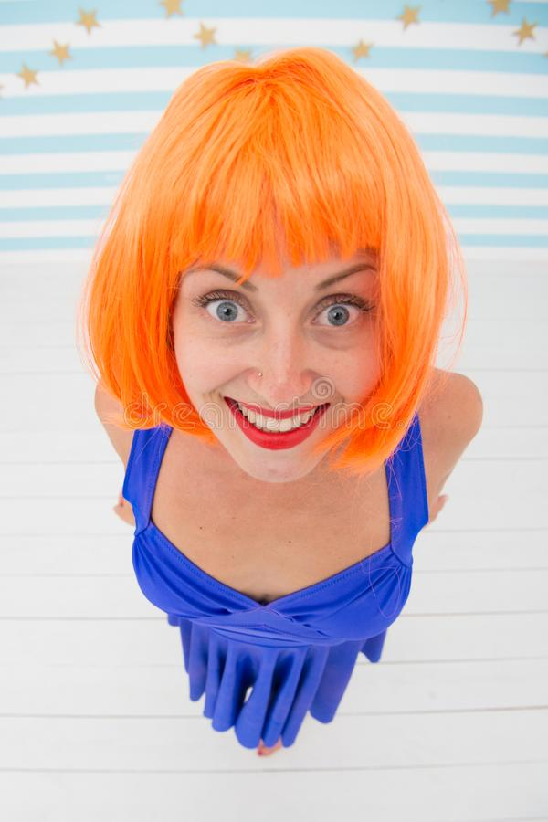 Wow. it looks perfect. crazy girl looks incredible. wow look and positive emotions. what a nice surprise. orange hair of. Happy crazy girl. dont worry be happy royalty free stock images