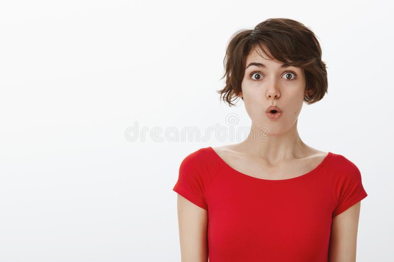 Wow something curious new. Impressed surprised tender silly woman short haircut folding lips say wow stare camera stock image