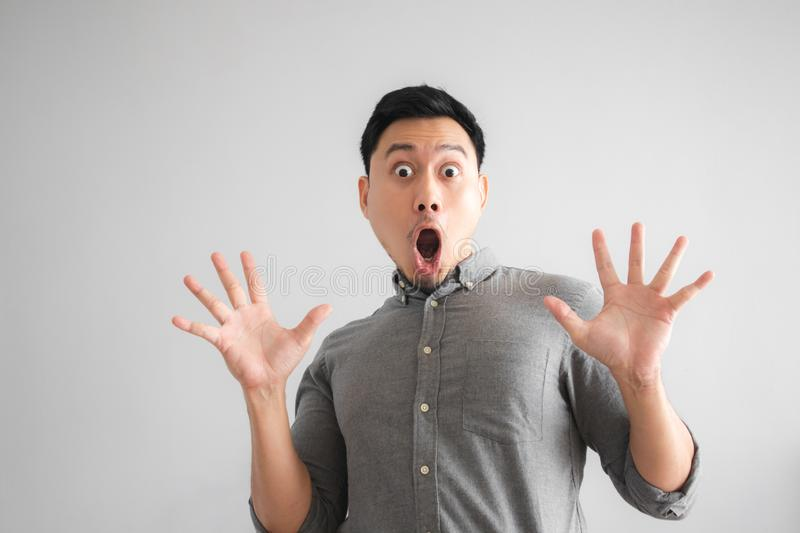 Wow and surprised face of funny good looking man with hand sign pointing royalty free stock photo
