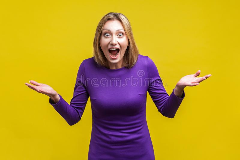 Wow, unbelievable! Portrait of positive astonished woman with widely open mouth and big eyes. isolated on yellow background. Wow, unbelievable! Portrait of royalty free stock image