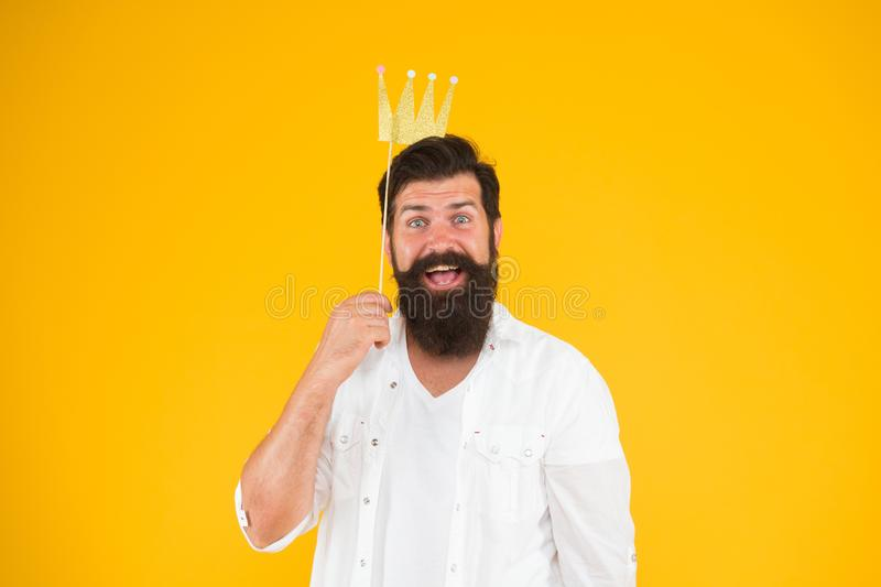 Wow what a surprise. happy birthday. hipster booth props yellow background. ready for fun. bearded man party crown. king stock photography