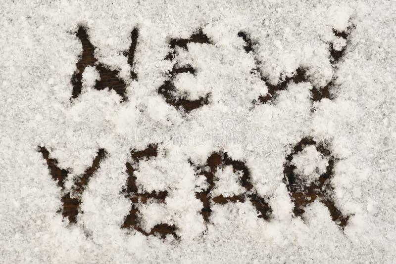 Wpisowy nowy rok na białym śniegu Tło dla zima wakacje tematu fotografia royalty free