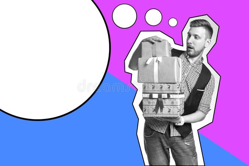 Wpisowy szablonu mężczyzna mienia pudełko z Bożenarodzeniowymi prezentami w rękach Brodaty modniś daje Bożenarodzeniowym prezento fotografia royalty free