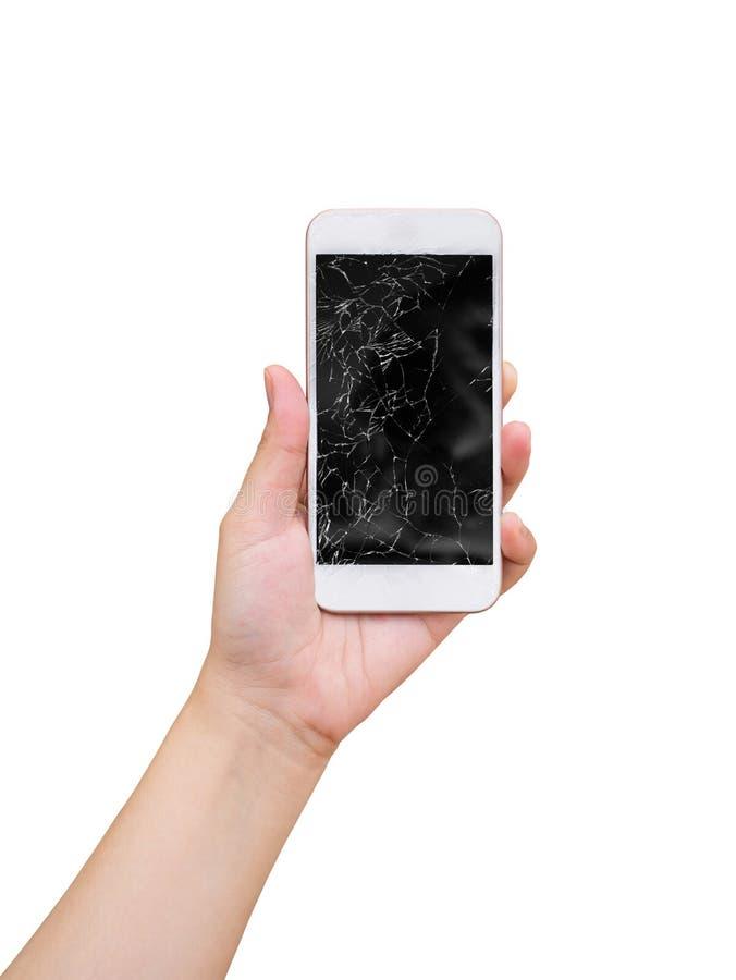 Wręcza chwyta telefon komórkowego z łamanym szklanym parawanowym pokazem odizolowywającym na bielu obraz royalty free