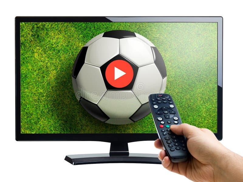 Wręcza dalekiego kontrolera wskazuje przy futbolowego dopasowania wideo pokazem obrazy royalty free