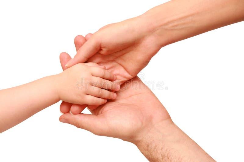 Wręcza dziecka w rodzic rękach obrazy royalty free