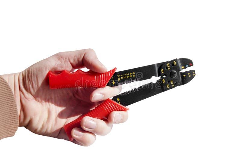 Wręcza mienie czerwień i czarnego wyposażenie klingeryt metalu krajacza i fotografia stock