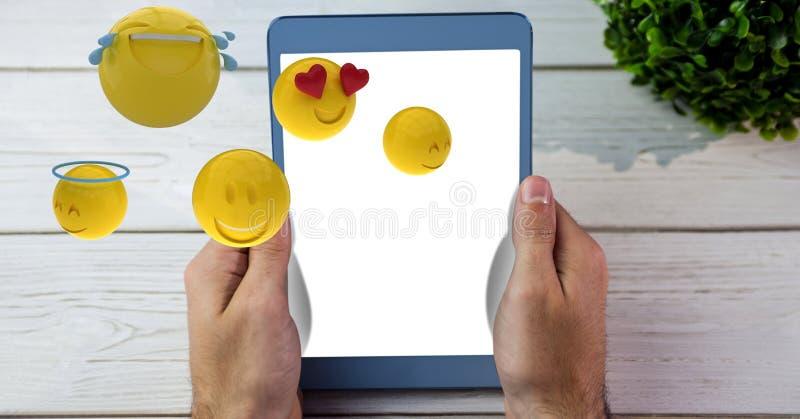 Wręcza mienie pastylki peceta podczas gdy emojis lata nad stołem ilustracji