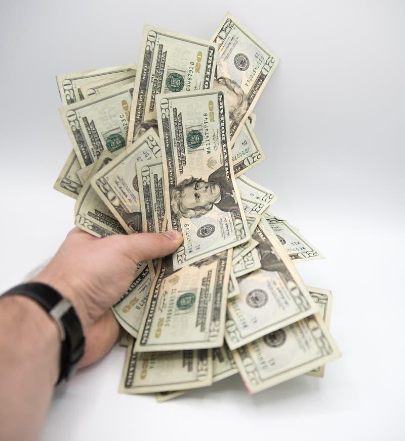 Wręcza mienie pieniądze, amerykanin dwadzieścia dolarów rachunków na białym bac obrazy stock