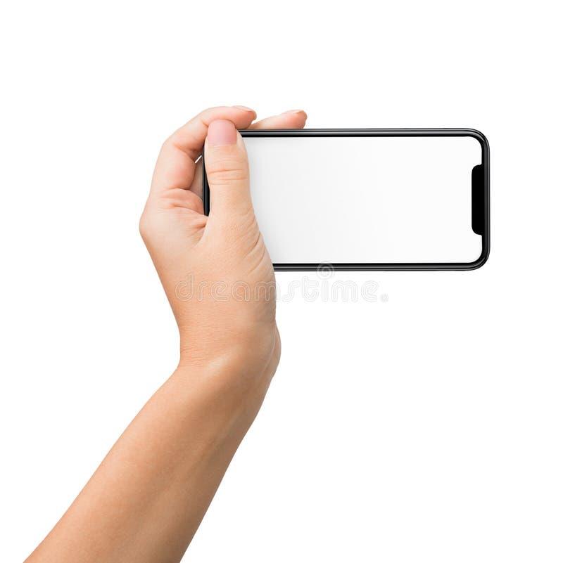 Wręcza mienie telefon komórkowego w horyzontalnej pozycji dla mockup fotografia royalty free
