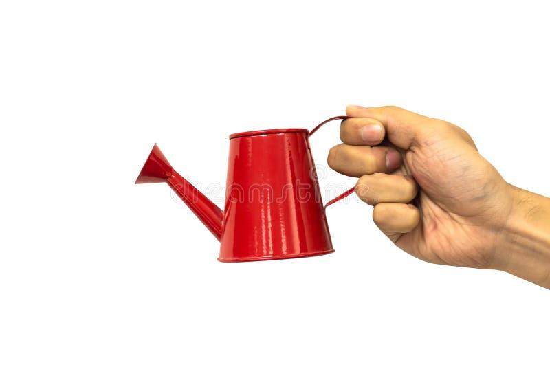 Wręcza mieniu czerwoną podlewanie puszkę odizolowywającą na białym tła clipp zdjęcie royalty free