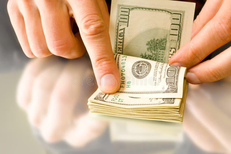 wręcza pieniądze fotografia royalty free