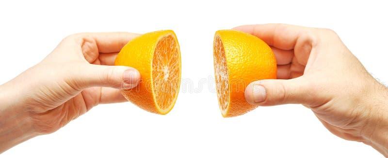wręcza pomarańcze dwa zdjęcia royalty free