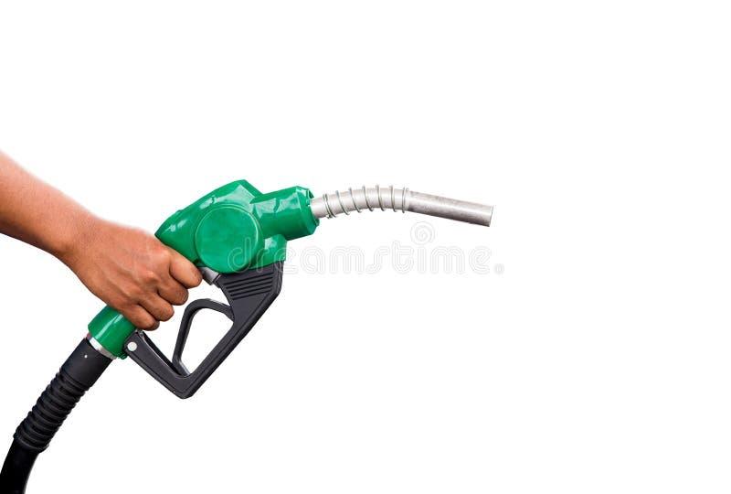 Wręcza trzymać benzynowego nozzle z jeden kopyto_szewski kroplą Mężczyzna trzyma zielonego benzyny nozzle na białym tle obraz royalty free