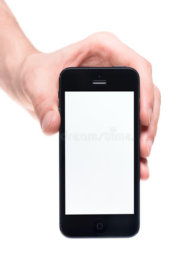 Wręcza trzymać Jabłczanego iphone 5 z pustym ekranem zdjęcie stock