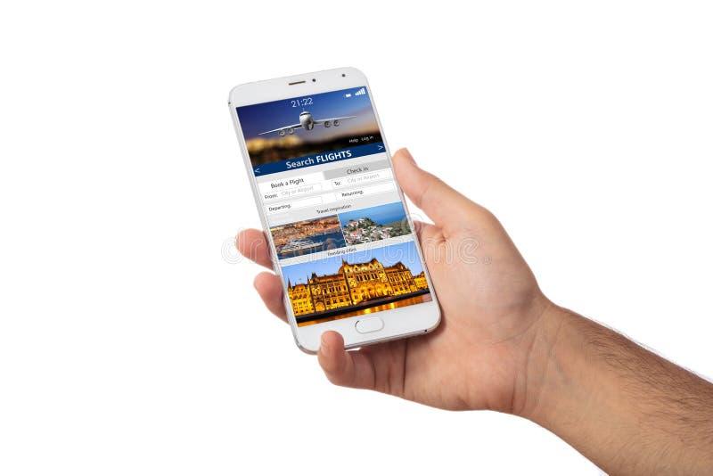 Wręcza trzymać smartphone, rewizja loty na ekranie, odizolowywającym na białym backgound obrazy stock