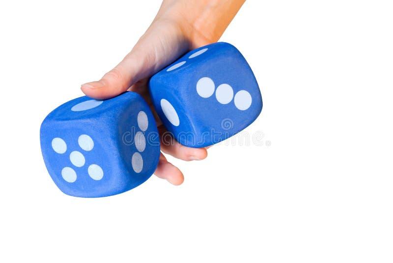 Ręka stacza się kostka do gry zdjęcie stock