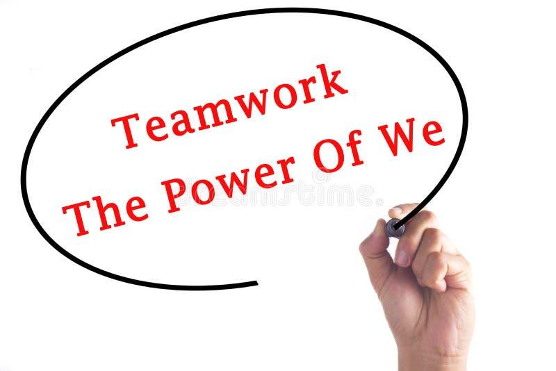 Wręcza writing pracie zespołowej władzę My na przejrzystej desce obrazy stock
