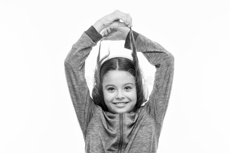 Wrap and go. Small girl with brunette hair isolated on white. Adorable child with hair wrapped around earphones. Little stock photo