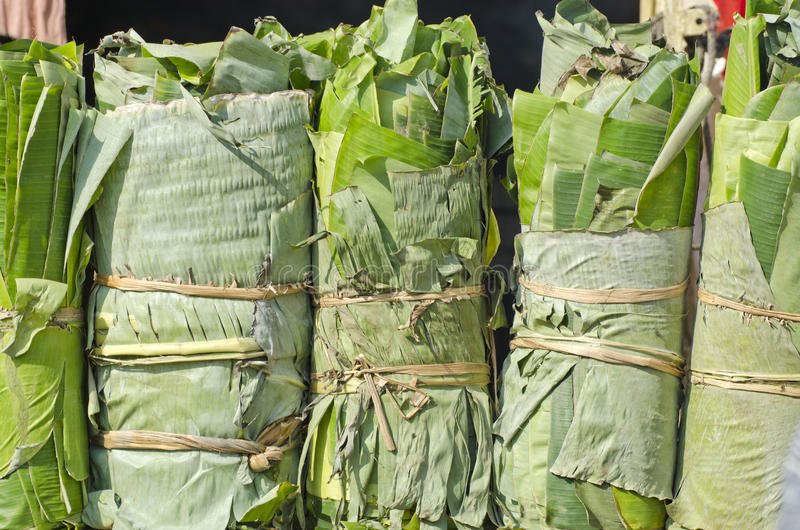 Wrapped banana leaves in asian market, India stock photo
