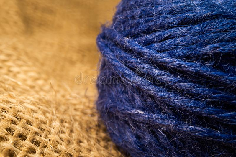 Wrapped blue rope  on natural linen fabric. Macro shooting royalty free stock photo