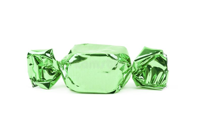 Wrapped candy isolated. Over the white background stock photography