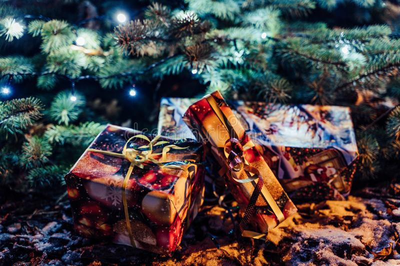 Wrapped Christmas Presents Under the Christmas Tree with Lights royalty free stock image