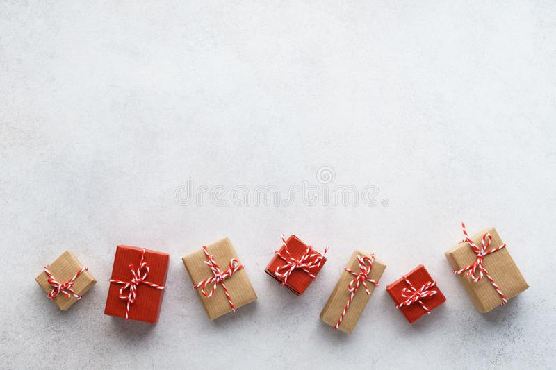 Wrapped gift boxes on light gray background. Seasonal sale stock photography