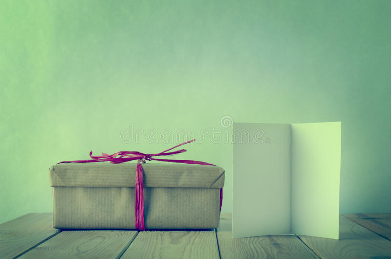Wrapped Gift in Brown Paper with Blank Card stock images