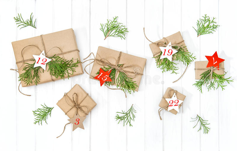 Wrapped gifts Advent calendar christmas tree branches decoration stock image