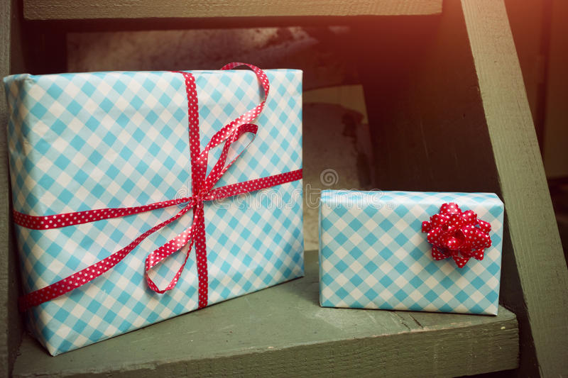 Wrapped gifts and candies stock images