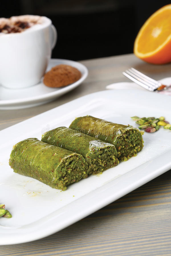 Wrapped green pistachio nuts baklava - Sarma plate royalty free stock photography
