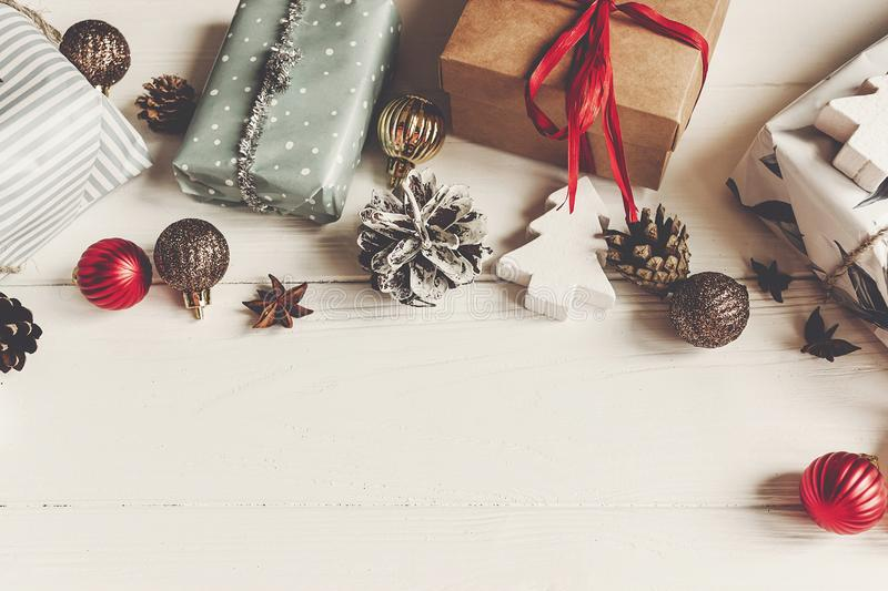 Wrapped present boxes with ornaments pine cones anise on white w royalty free stock photography