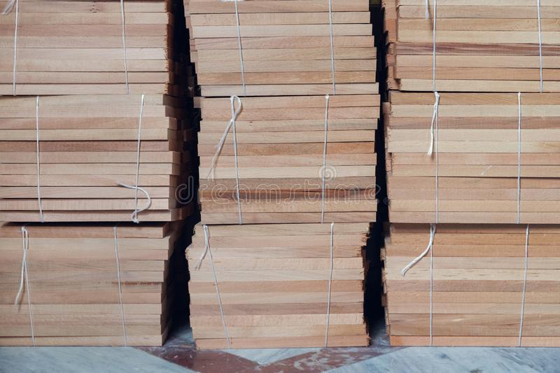 Wrapped stacks of wooden parquet. On the floor royalty free stock photo