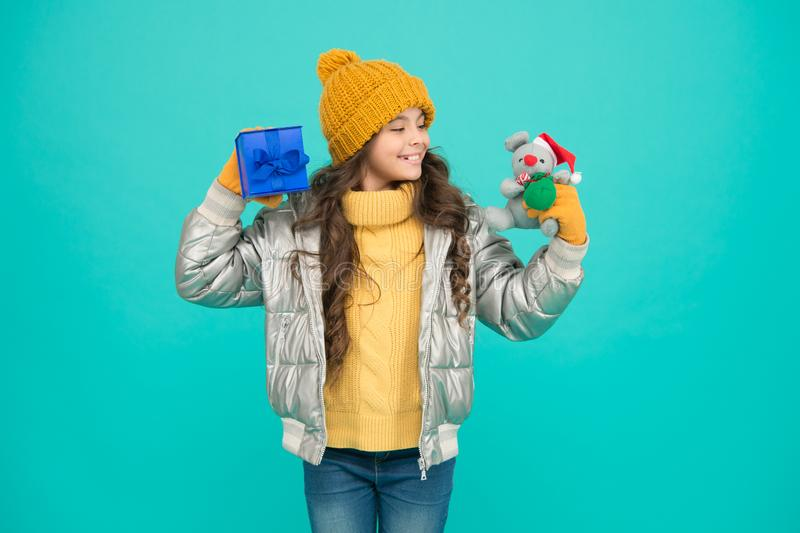 Wrapping box. Wrapping gifts. Idea of wrapping. Receiving presents. Girl winter clothes hold gift box toy. Buy gifts. Profitable deals and seasonal discount royalty free stock photo