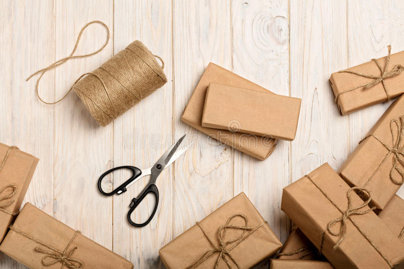 Wrapping Christmas gifts in Kraft paper and rope. stock image