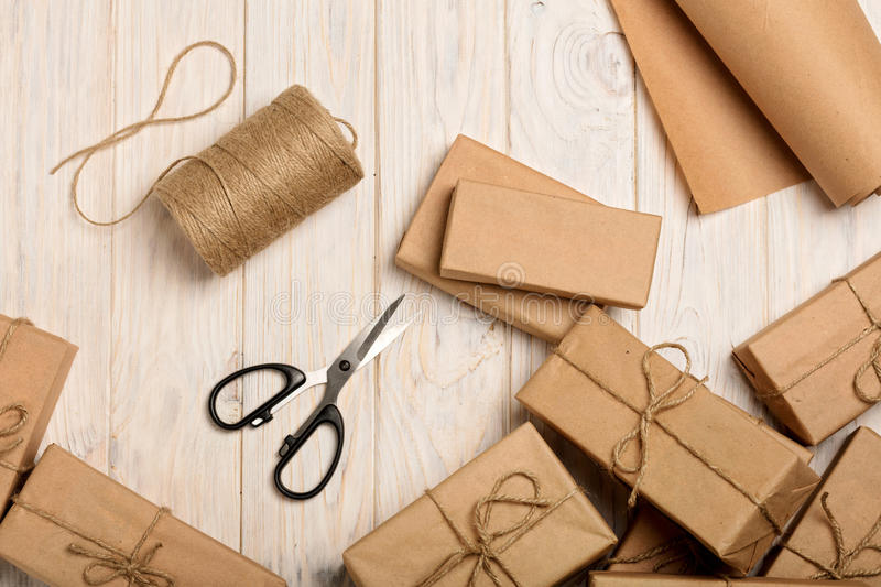 Wrapping Christmas gifts in Kraft paper and rope. Selective focus royalty free stock photos