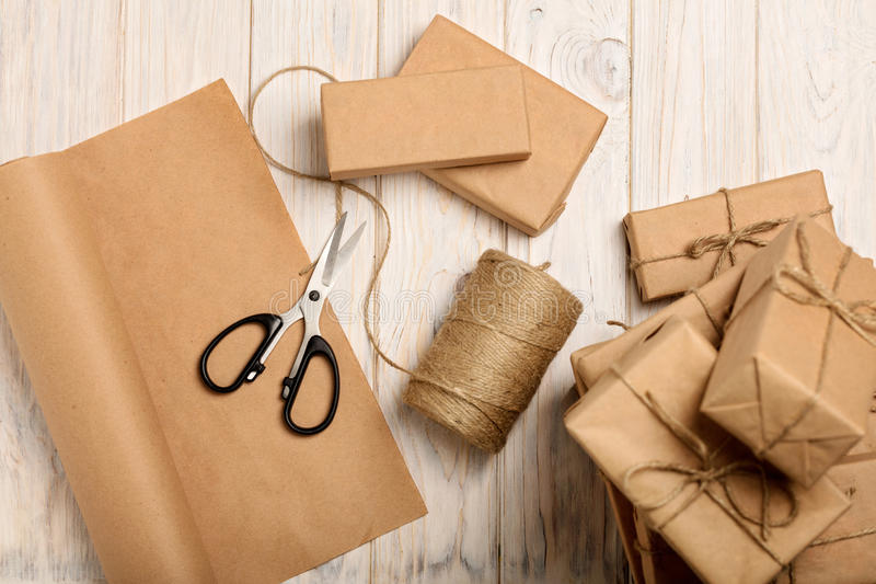 Wrapping Christmas gifts in Kraft paper and rope. royalty free stock image