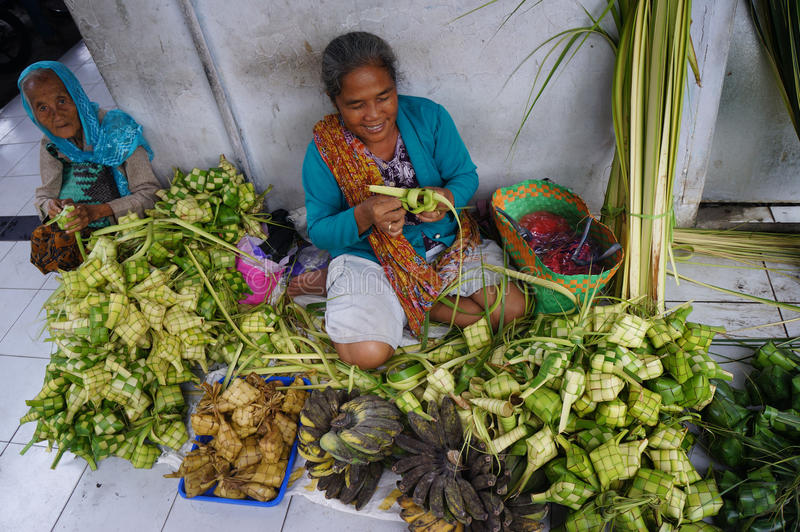 Wrapping food. Merchants sell food wrapping from palm leaves in Madiun, East Java, Indonesia royalty free stock images