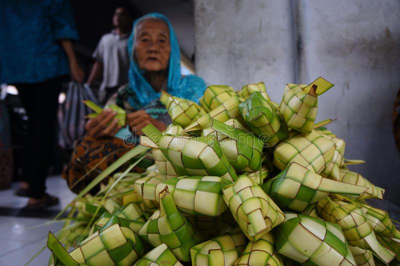 Wrapping food. Merchants sell food wrapping from palm leaves in Madiun, East Java, Indonesia stock photos