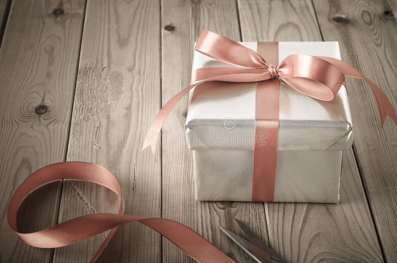 Wrapping of Gift Box with Vintage Effect stock image