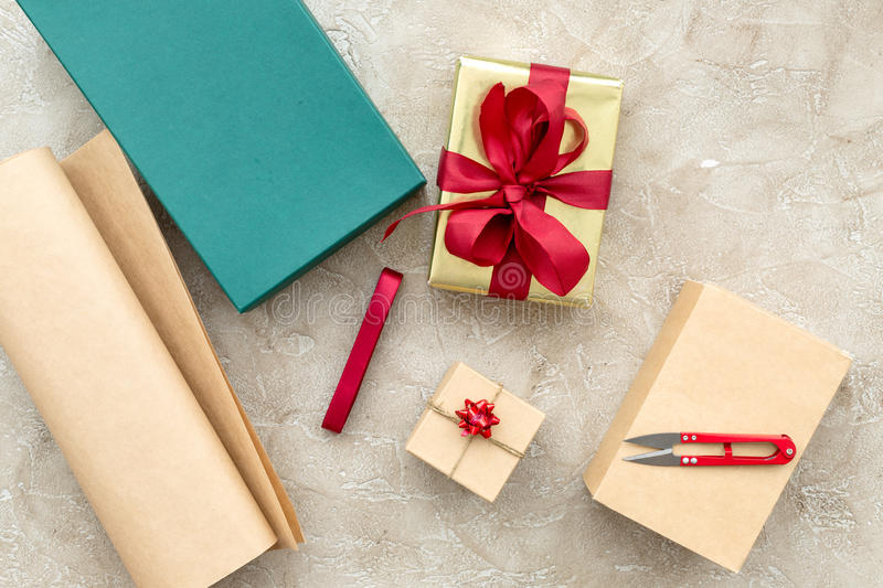 Wrapping gifts in box for holiday top view mock up.  stock image