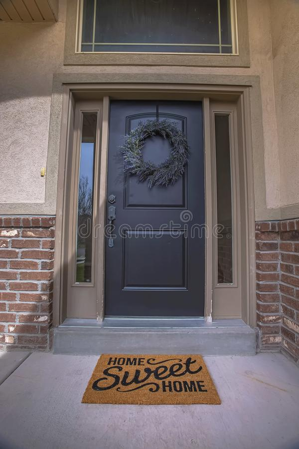 Free Wreath And Doormat On The Front Door With Sidelights And Transom Window Stock Image - 153003171