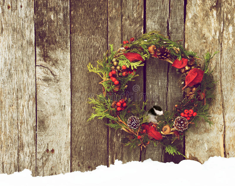 Download Wreath With Chickadee Peeking Out. Royalty Free Stock Photo - Image: 27660235