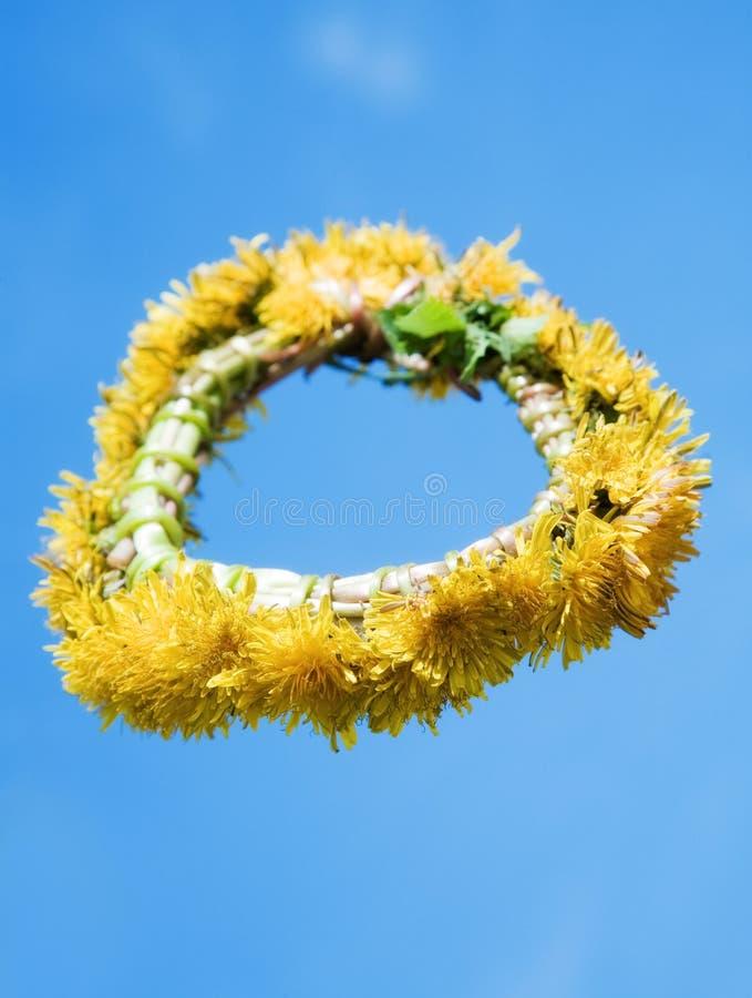The wreath of dandelions stock photos